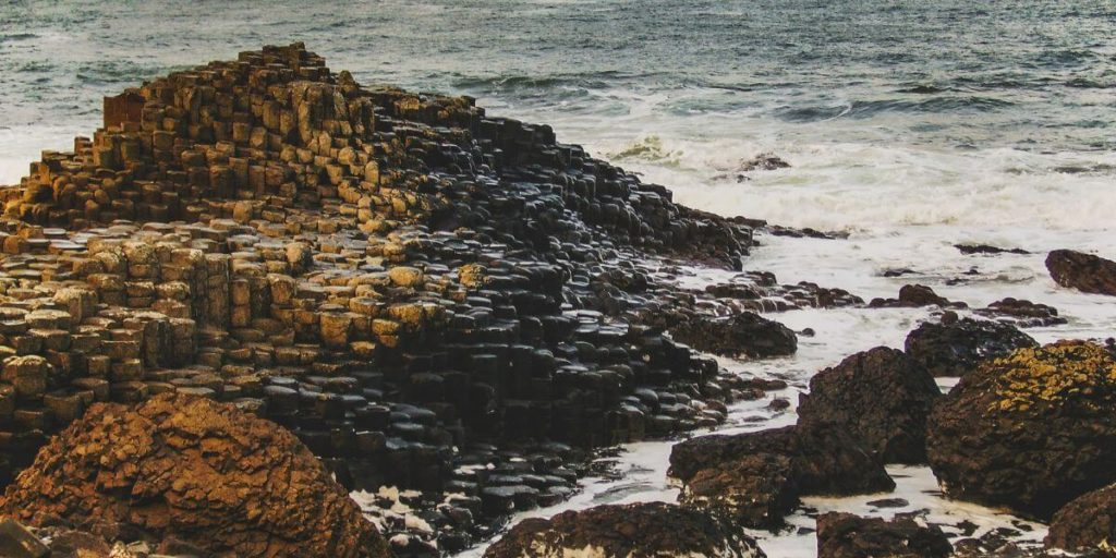 The hexagonal columns of the Giant's Causeway in Northern Ireland slowly lowering into the sea below